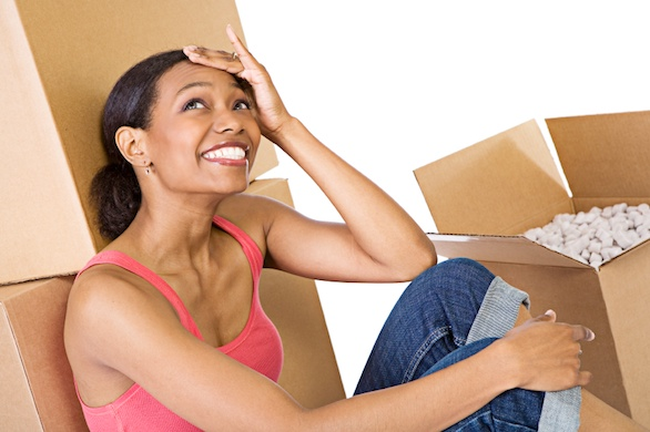 woman packing items into boxes