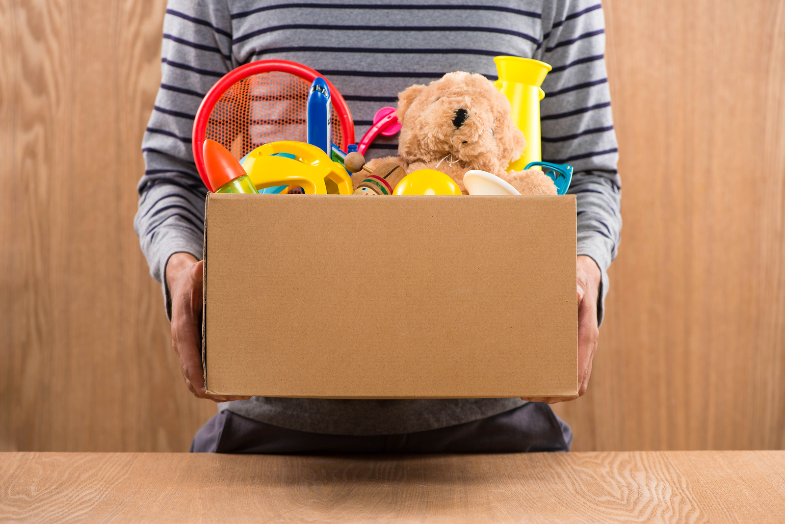 Volunteer Holding Donation Box With Toys