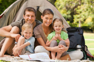 A family enjoying a weekend of camping before storing their tent, sleeping bag and other camping items