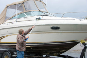A man cleaning his boat