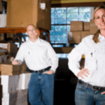 Business owners near inventory in a business storage unit