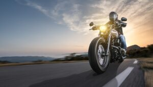 A new motorcycle owner going for a long drive at sunset.
